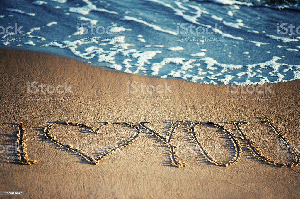 I love you - written in the sand royalty-free stock photo