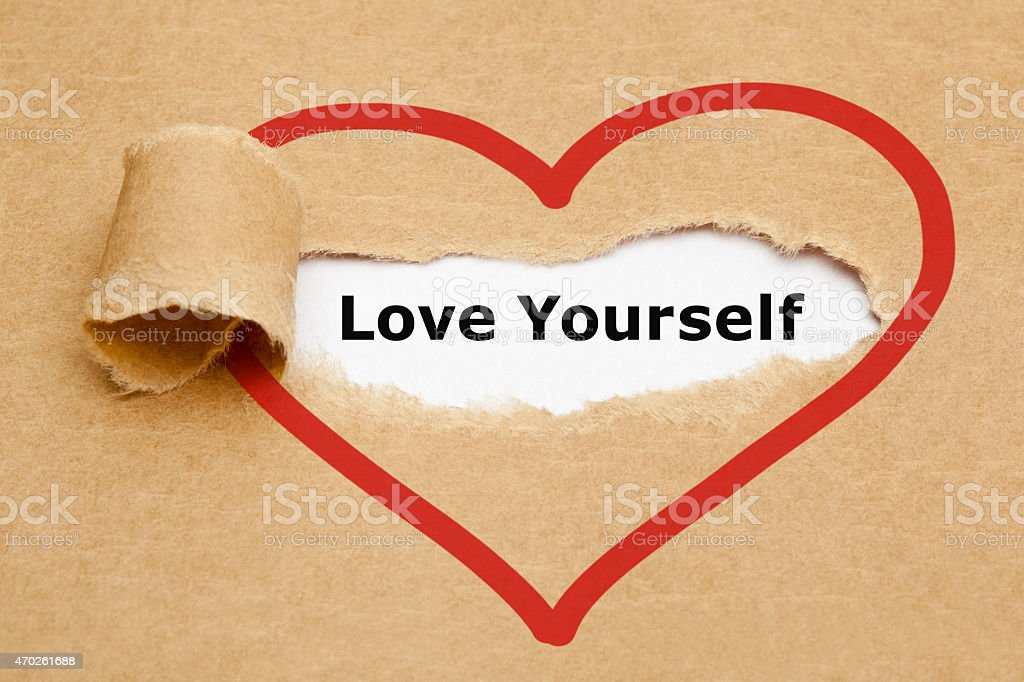 Love Yourself Torn Paper stock photo
