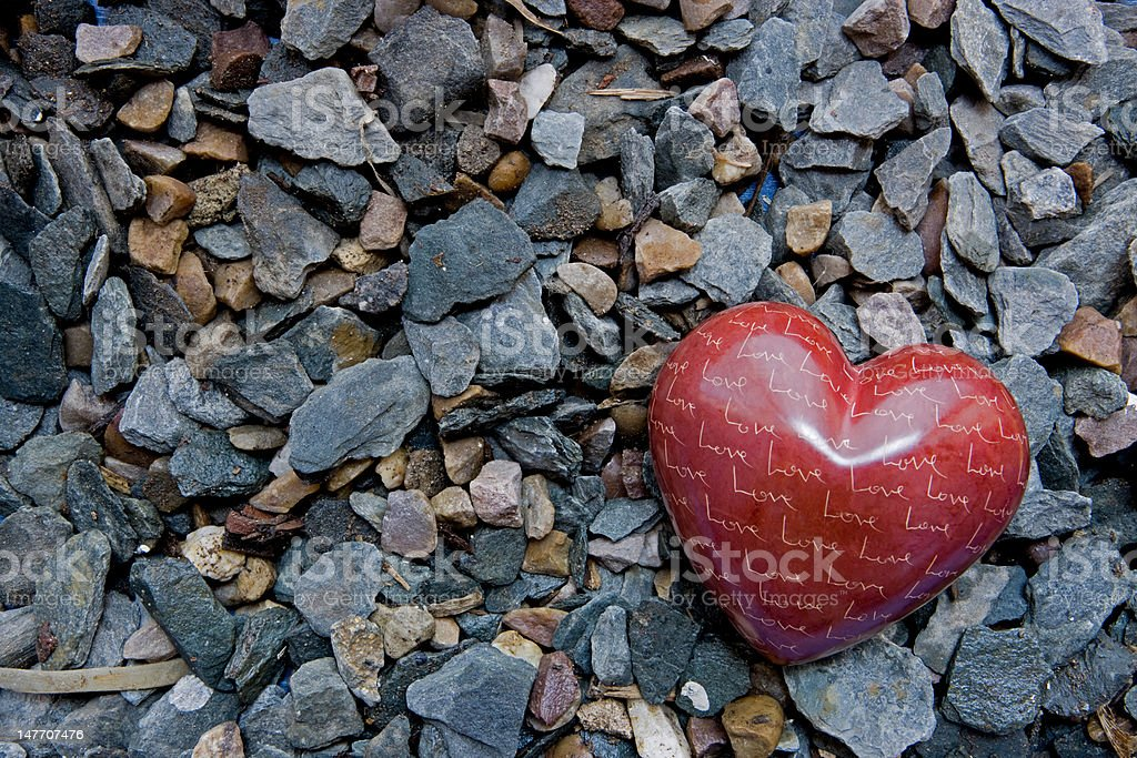 Loveheart on a bed of stone stock photo
