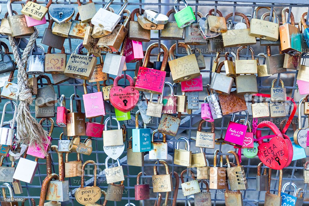 Lovelocks attached to a bridge railing in central Helsinki, Finland. stock photo