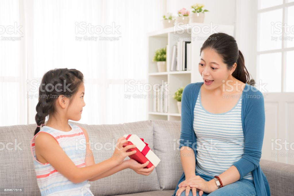 lovely asian little girl send a gift to her mother stock photo