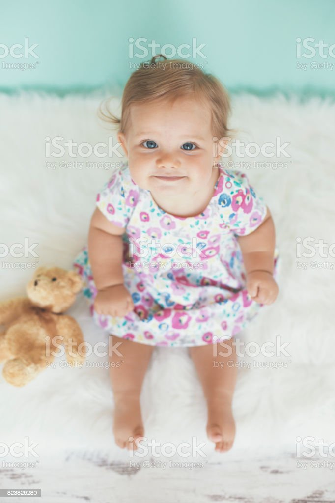 Lovely baby with toy stock photo