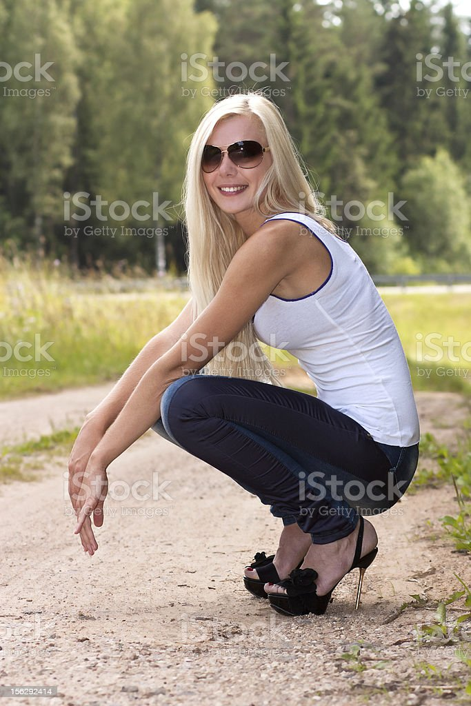 Lovely blond model in sun glasses outdoor royalty-free stock photo