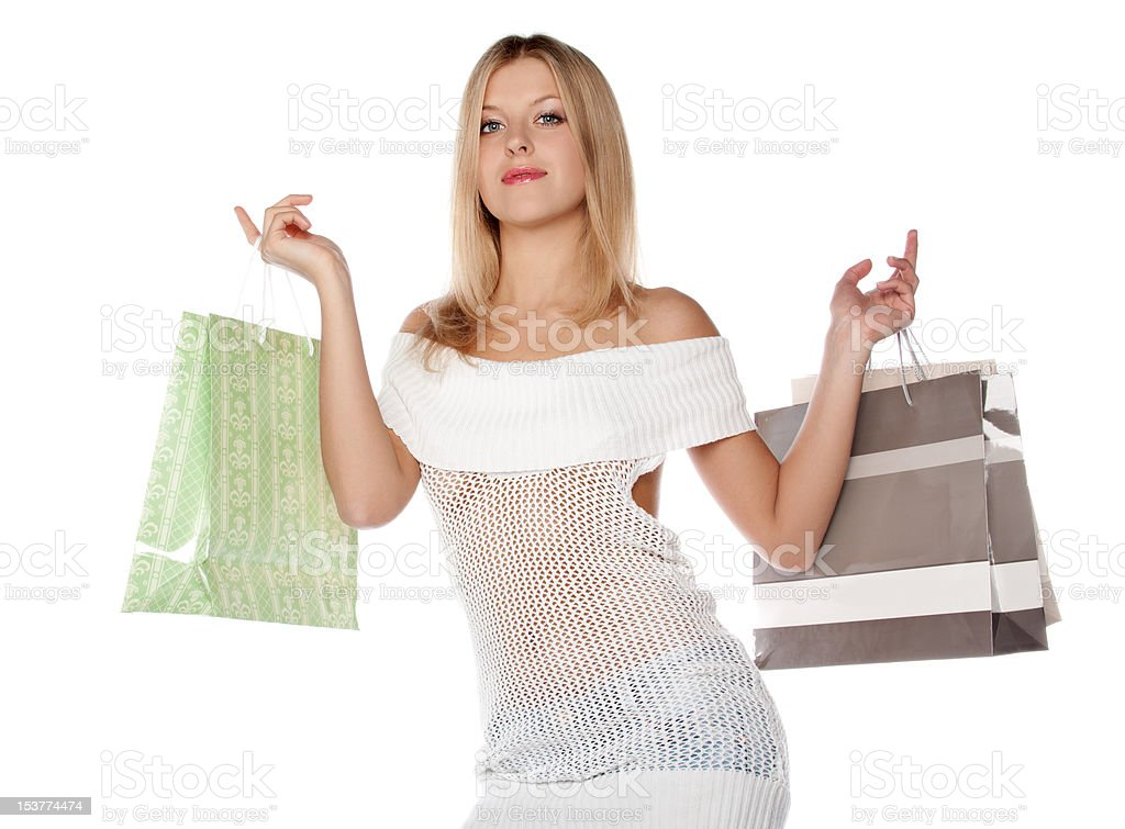 Bezaubernden blonden Frau mit Einkaufstüten auf Weiß Lizenzfreies stock-foto