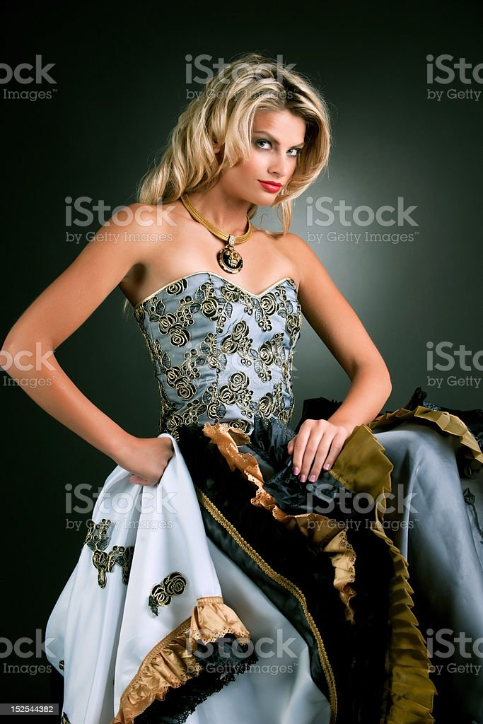 lovely blonde female fashion model in intricate gown royalty-free stock photo
