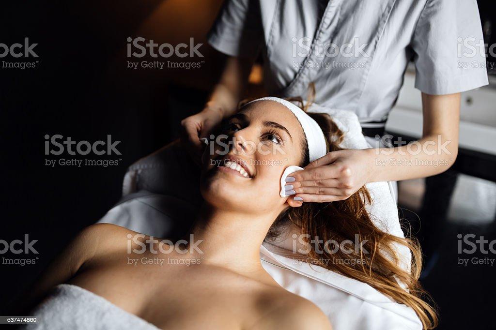 Lovely brunette enjoying massage stock photo