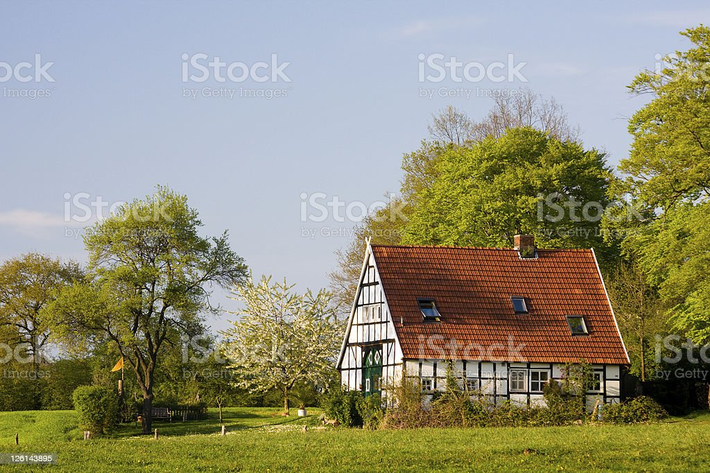 Lovely Cottage In Green Landscape royalty-free stock photo