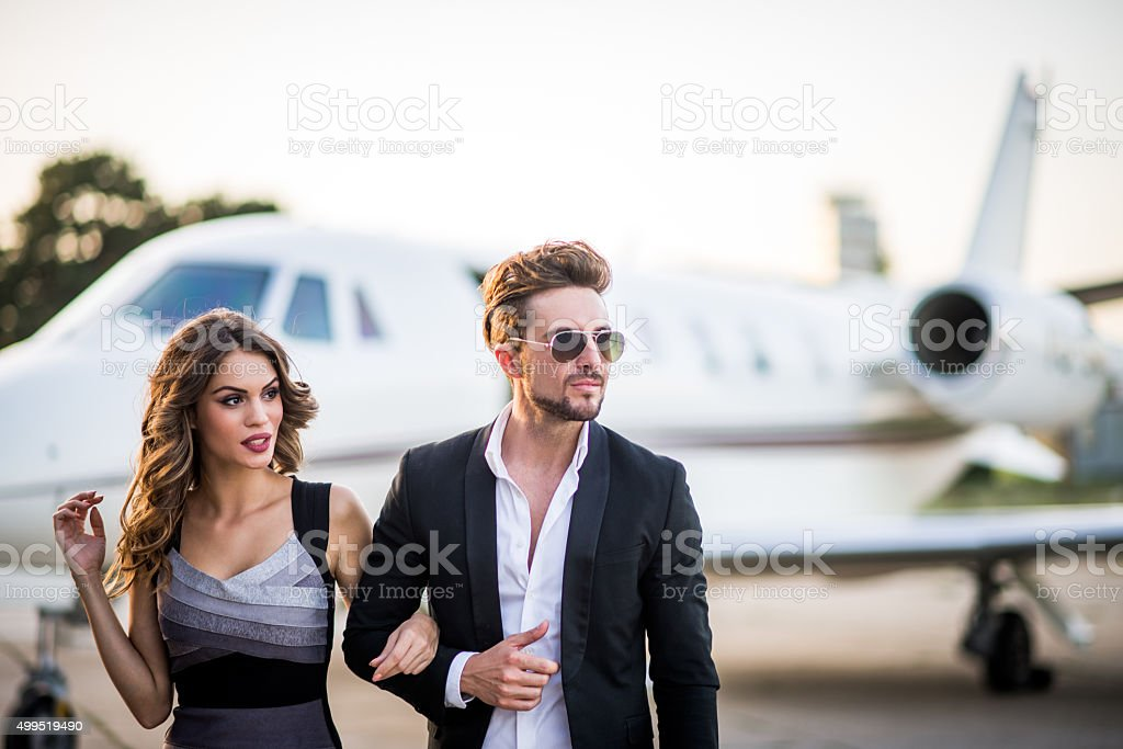 Lovely couple at the airport track stock photo