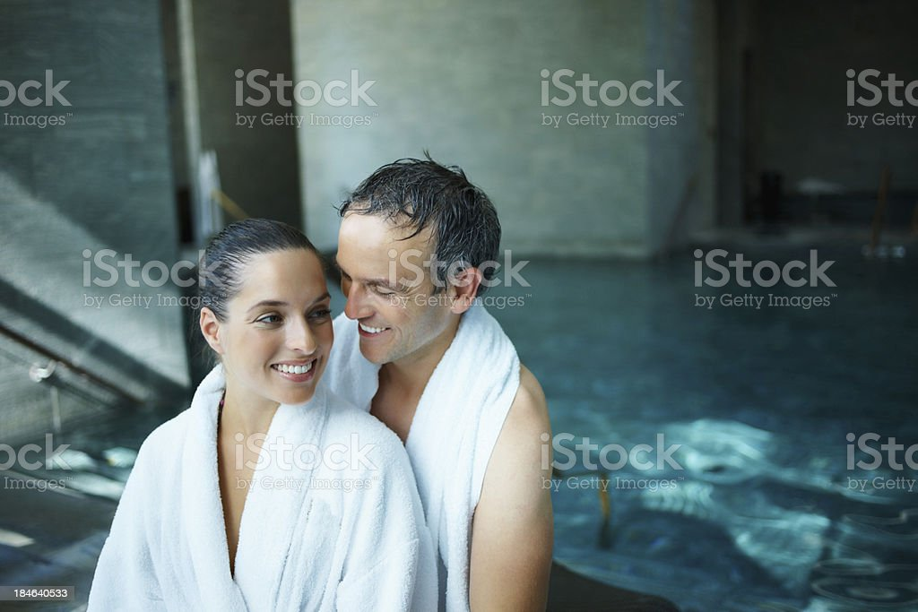Lovely couple by poolside royalty-free stock photo