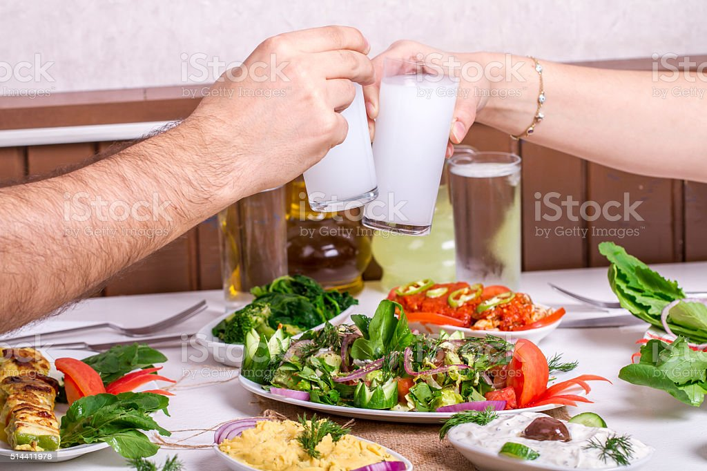 Lovely Couple, Drinking, Cheers and drinking  Drink Raki, Ouzo stock photo