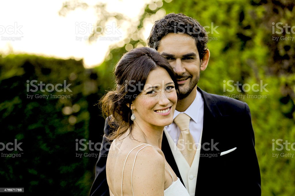 Lovely couple enjoying their wedding day stock photo