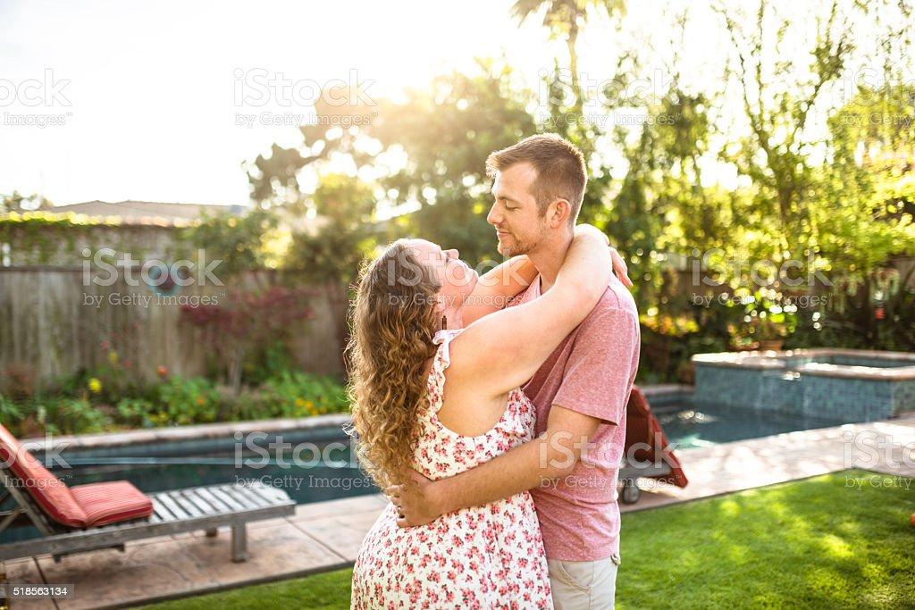 lovely couple flirting at sunset stock photo