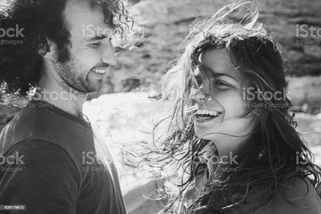 Lovely couple having fun in sunlight. Long curly hair, happiness stock photo