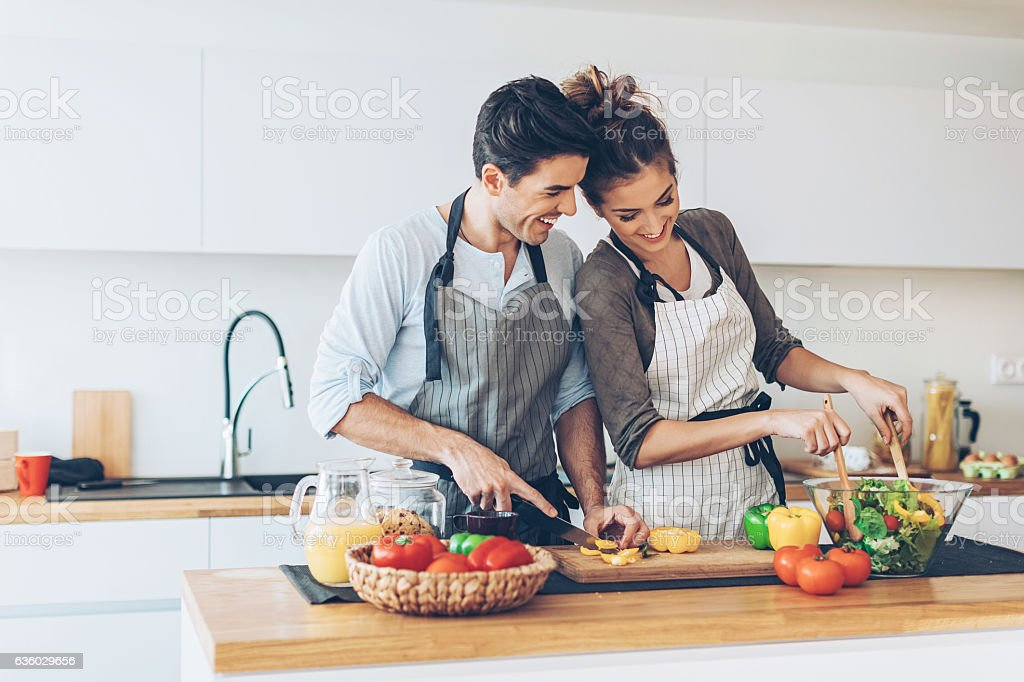 Lovely couple making salad stock photo