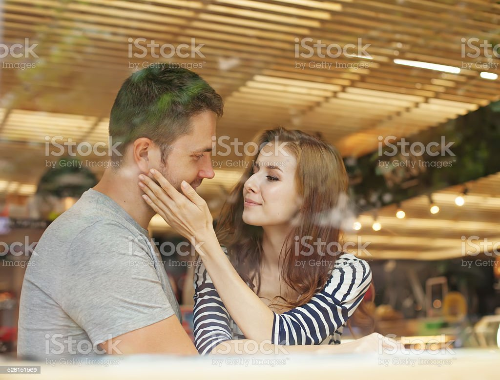 lovely couple sitting indoors in cafe stock photo