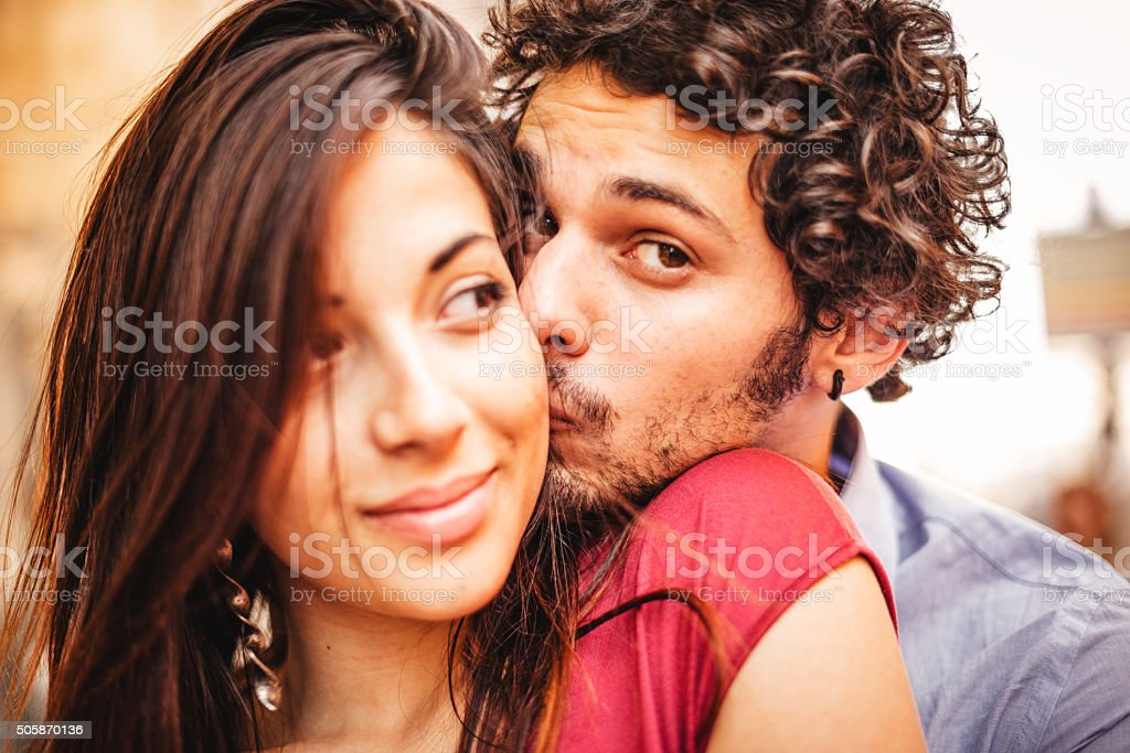 lovely couple togetherness at sunset stock photo