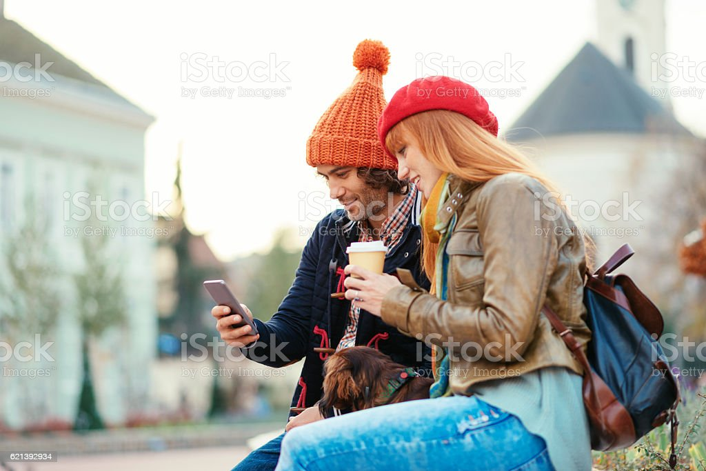 Lovely couple with dachshund dog spending time together stock photo