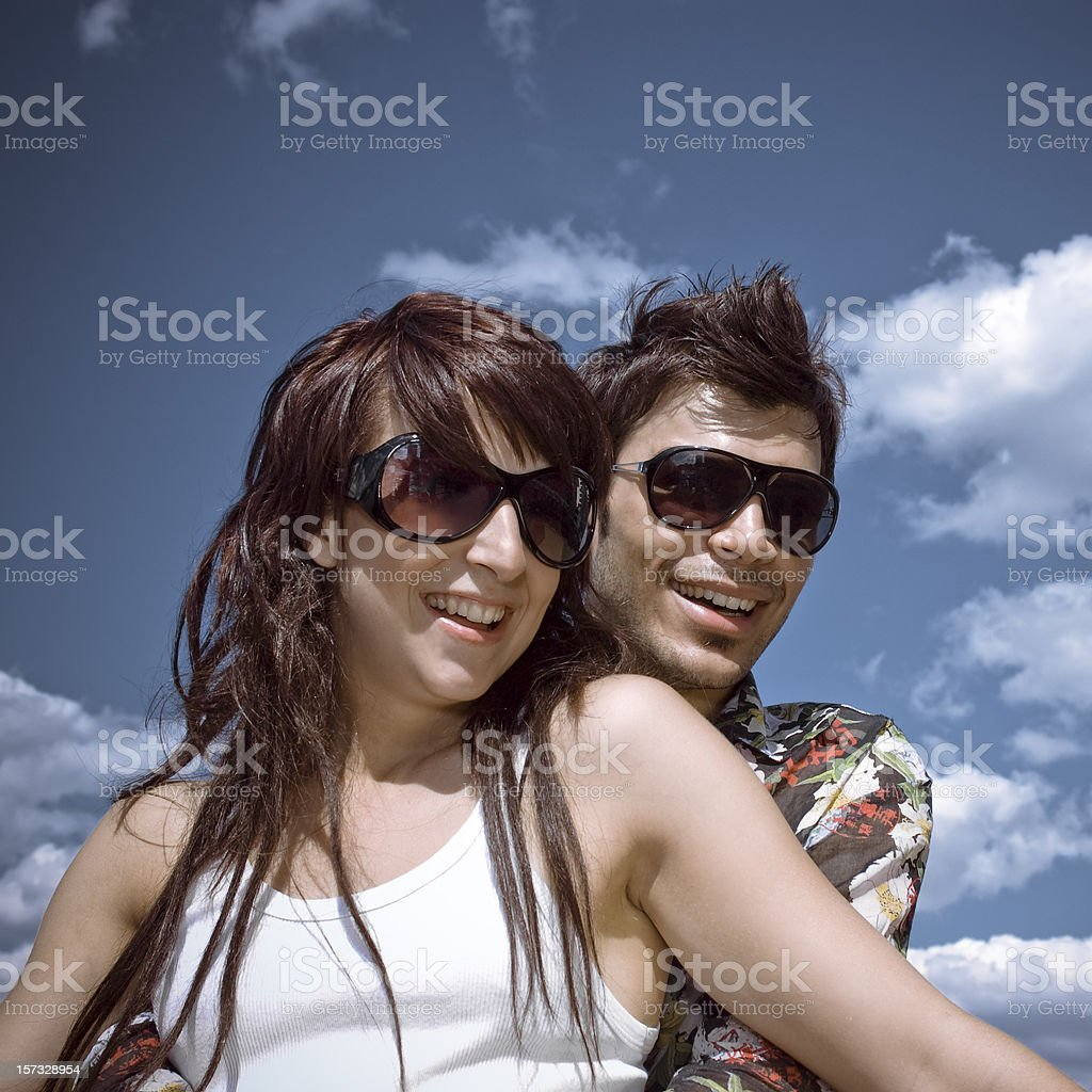 Lovely couple with huge sunglasses royalty-free stock photo