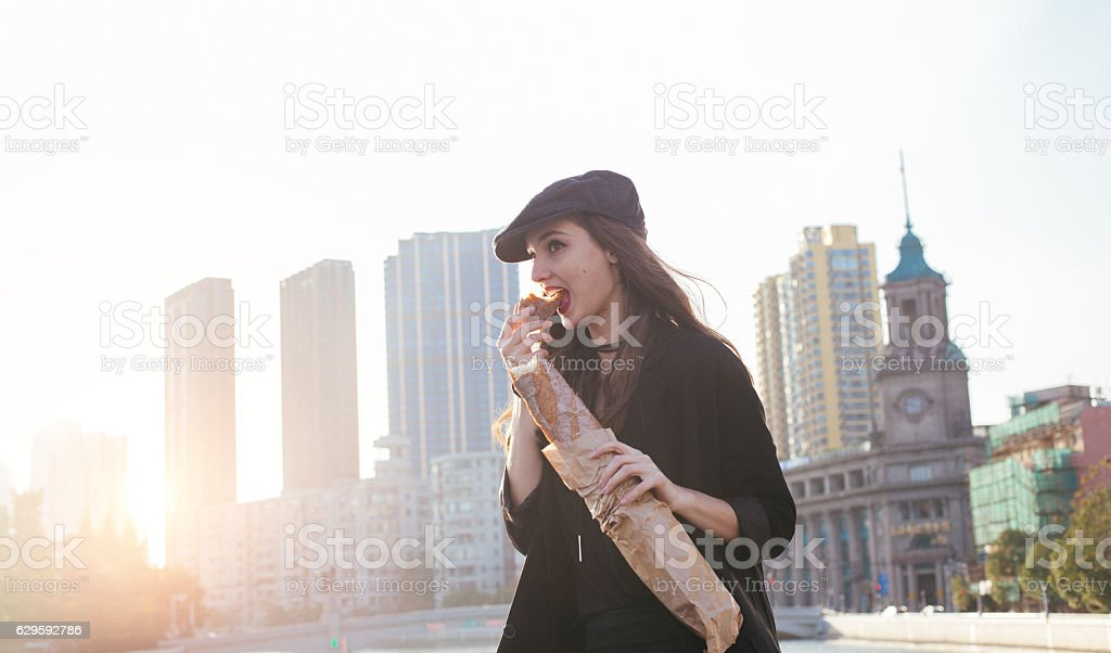 Young and beautiful modern woman enjoys a lovely day out in the city,...