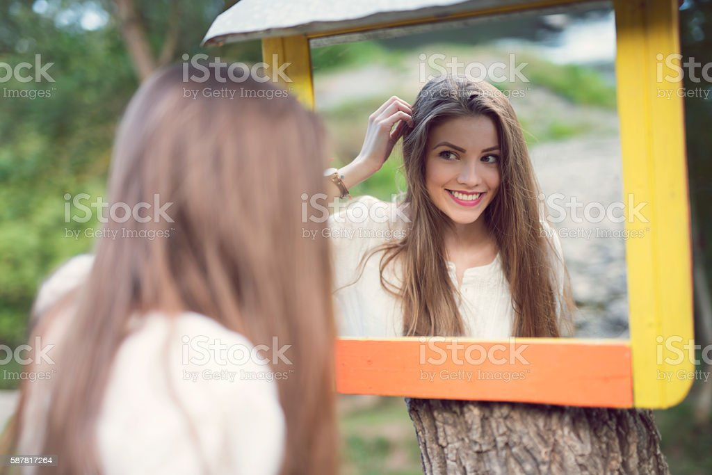 Lovely face in the mirror stock photo