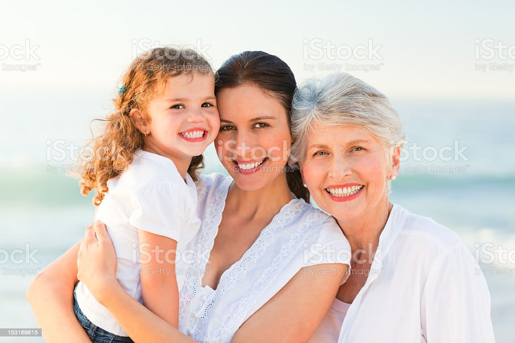Lovely family at the beach royalty-free stock photo