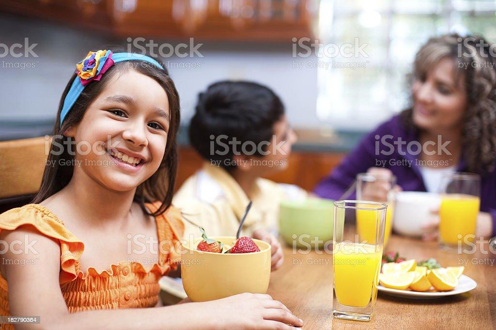Lovely family eating breakfast stock photo