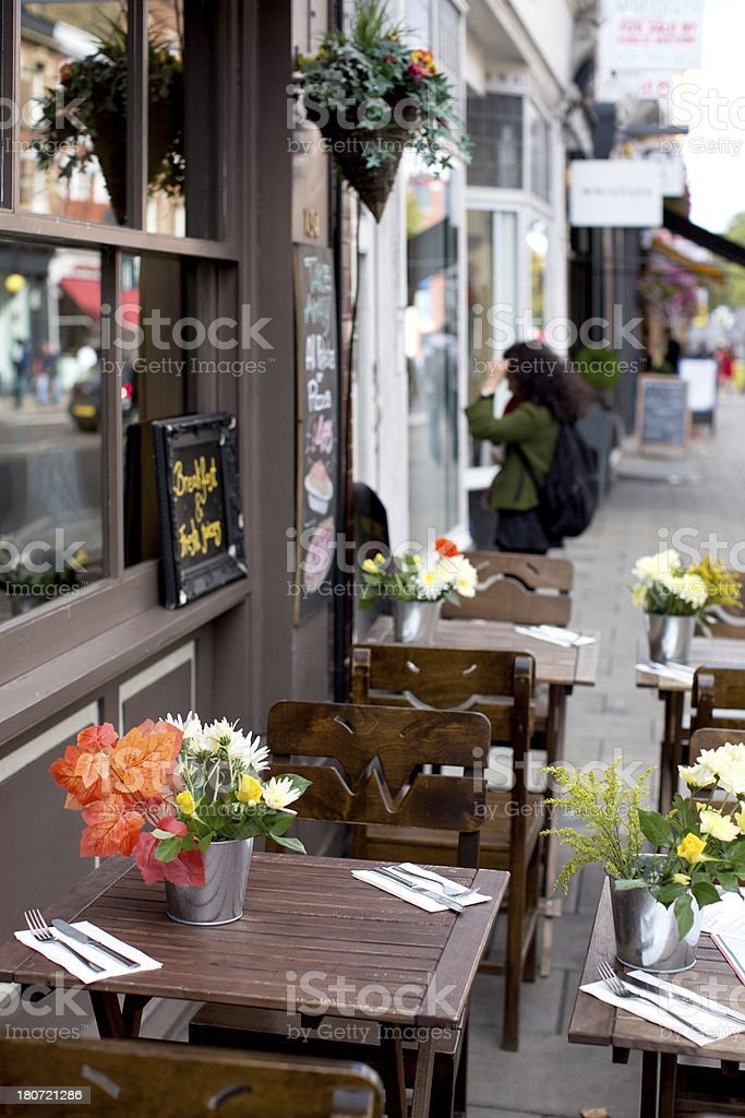 Lovely flowers at sidewalk cafe royalty-free stock photo