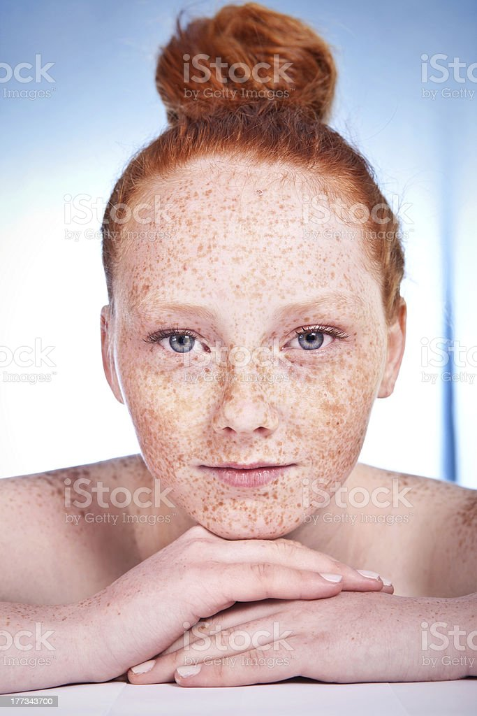 Lovely freckled girl stock photo
