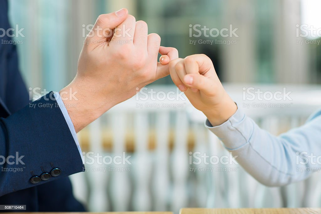 Lovely gesture with little fingers stock photo