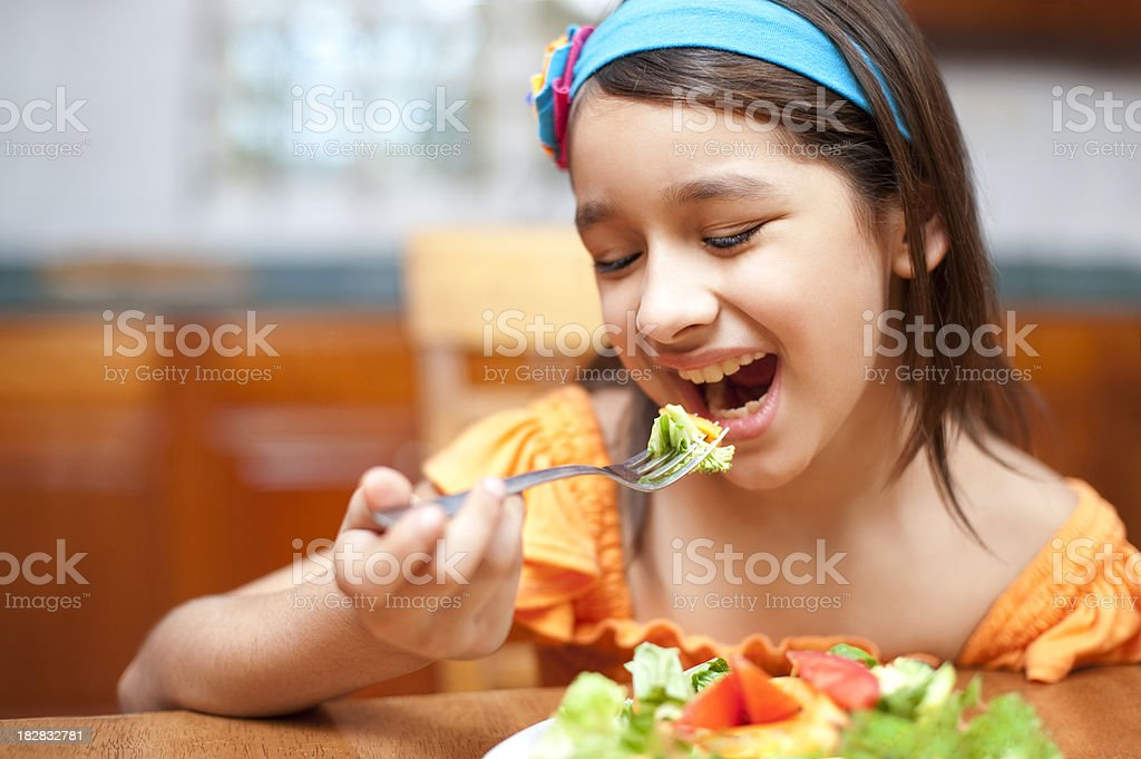 Lovely girl eating healthy stock photo