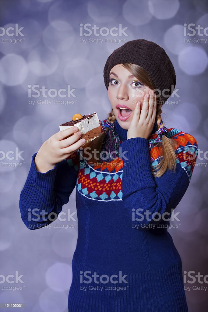 Lovely girl in sweater with cake. royalty-free stock photo