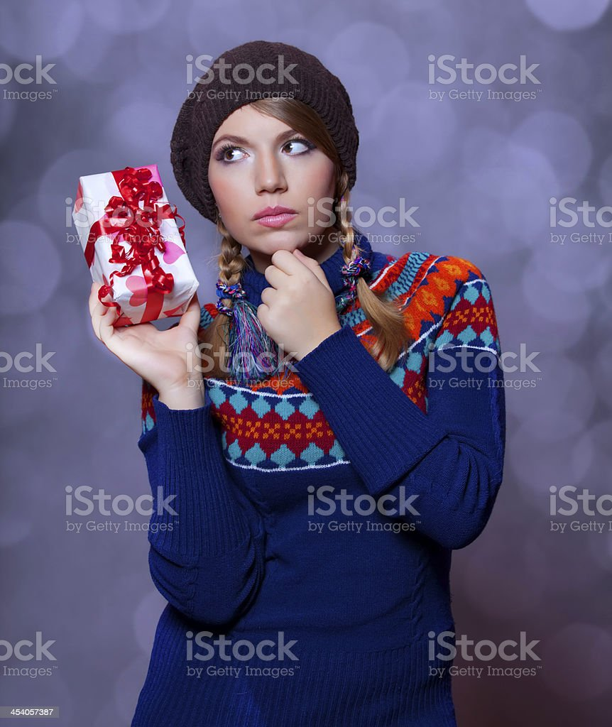 Lovely girl in sweater with gift royalty-free stock photo