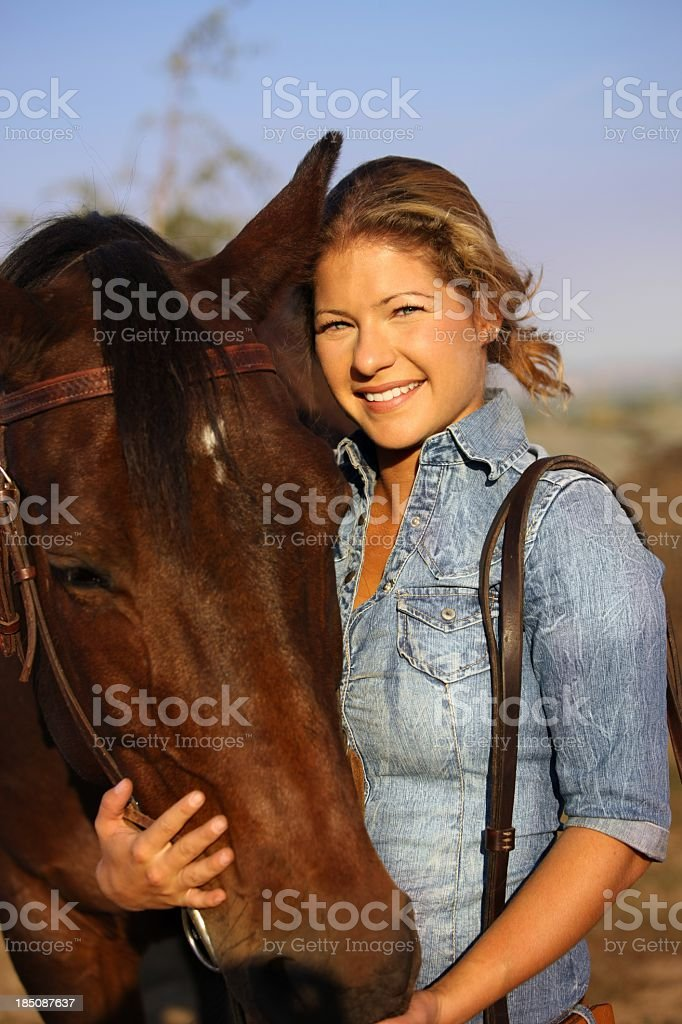 Lovely girl posing with her horse stock photo