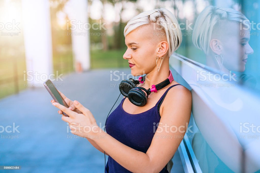 Lovely girl typing message to boyfriend stock photo