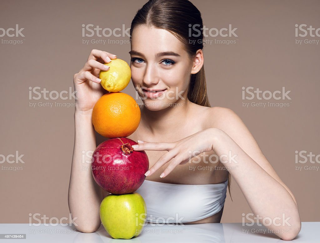 Lovely girl with fruits mix, natural organic raw fresh food stock photo