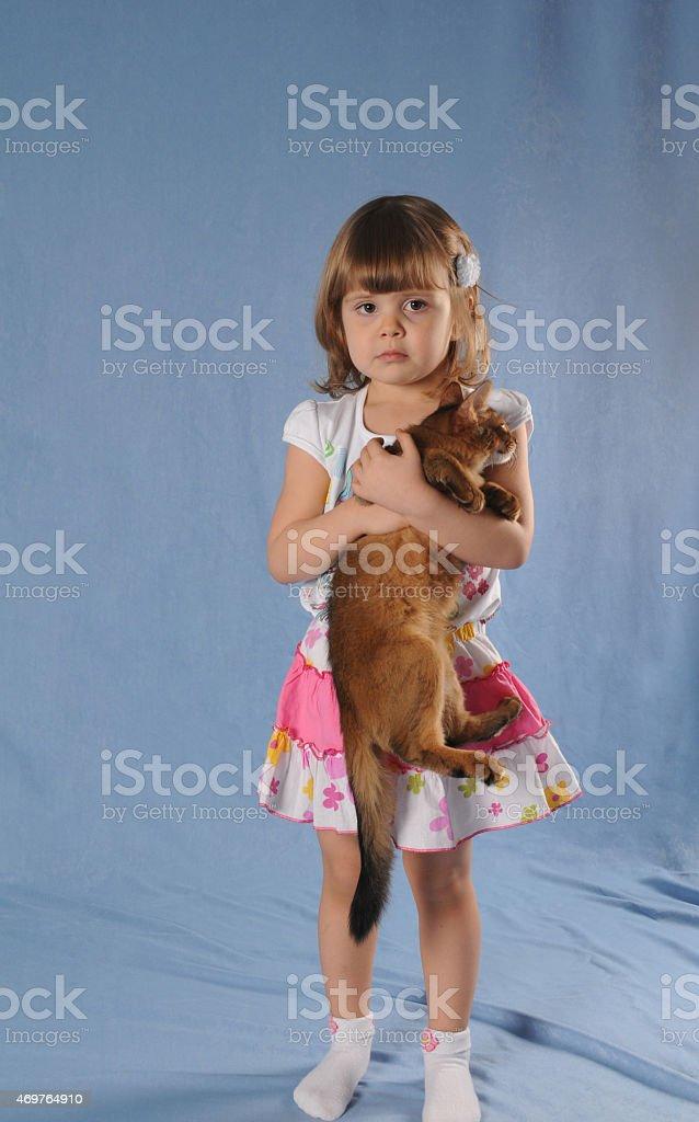 Lovely girl with kitten in hands portrait stock photo