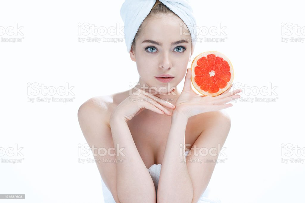 Lovely girl with pomelo slice stock photo