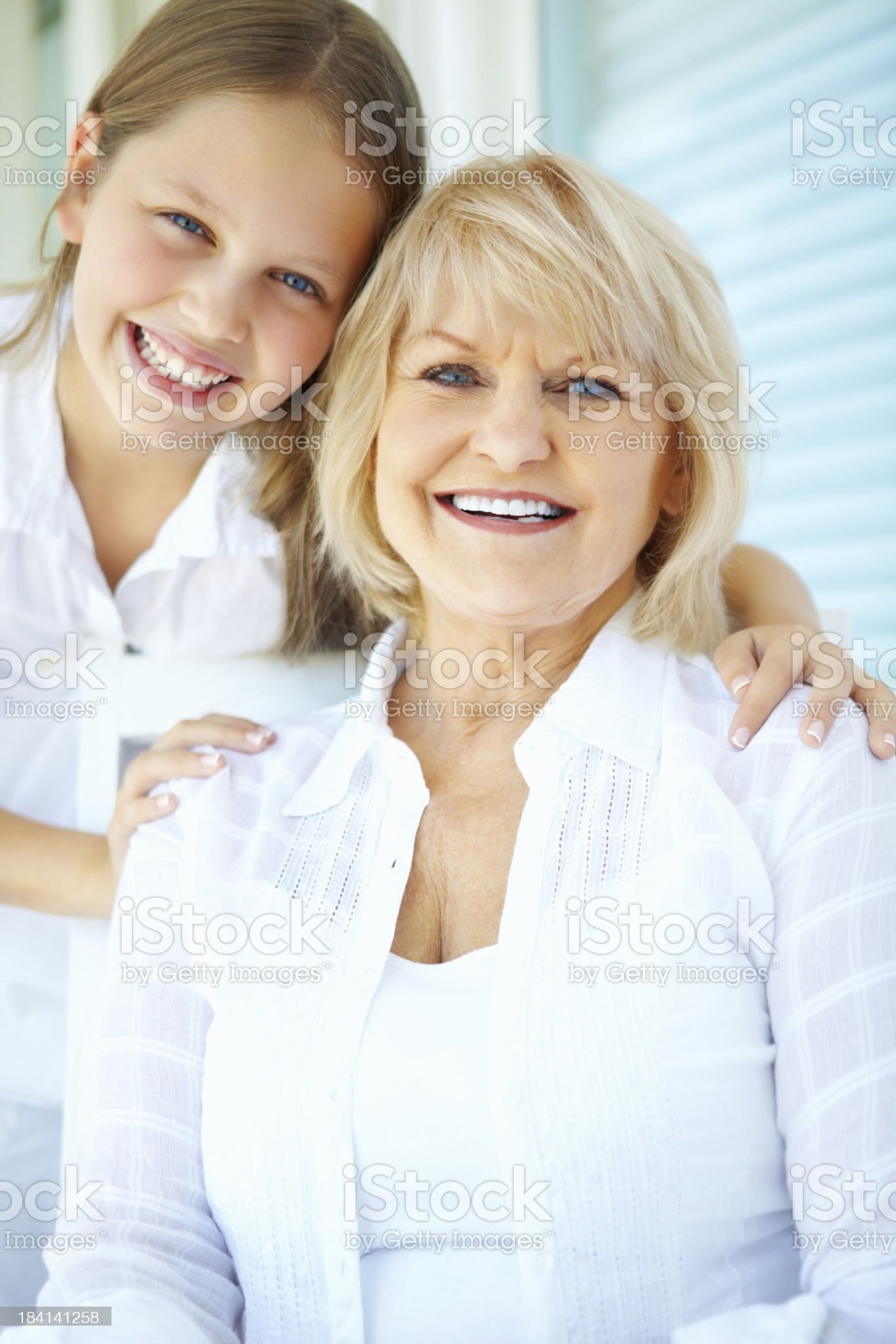 Lovely grandmother with cute granddaughter smiling royalty-free stock photo