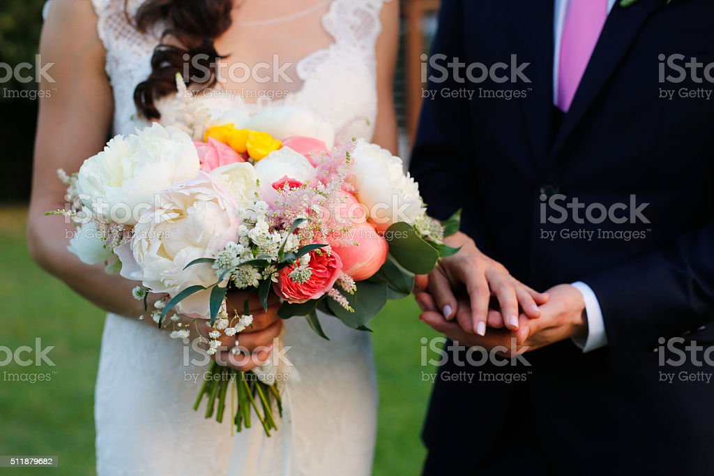 Lovely grooms holding each other stock photo