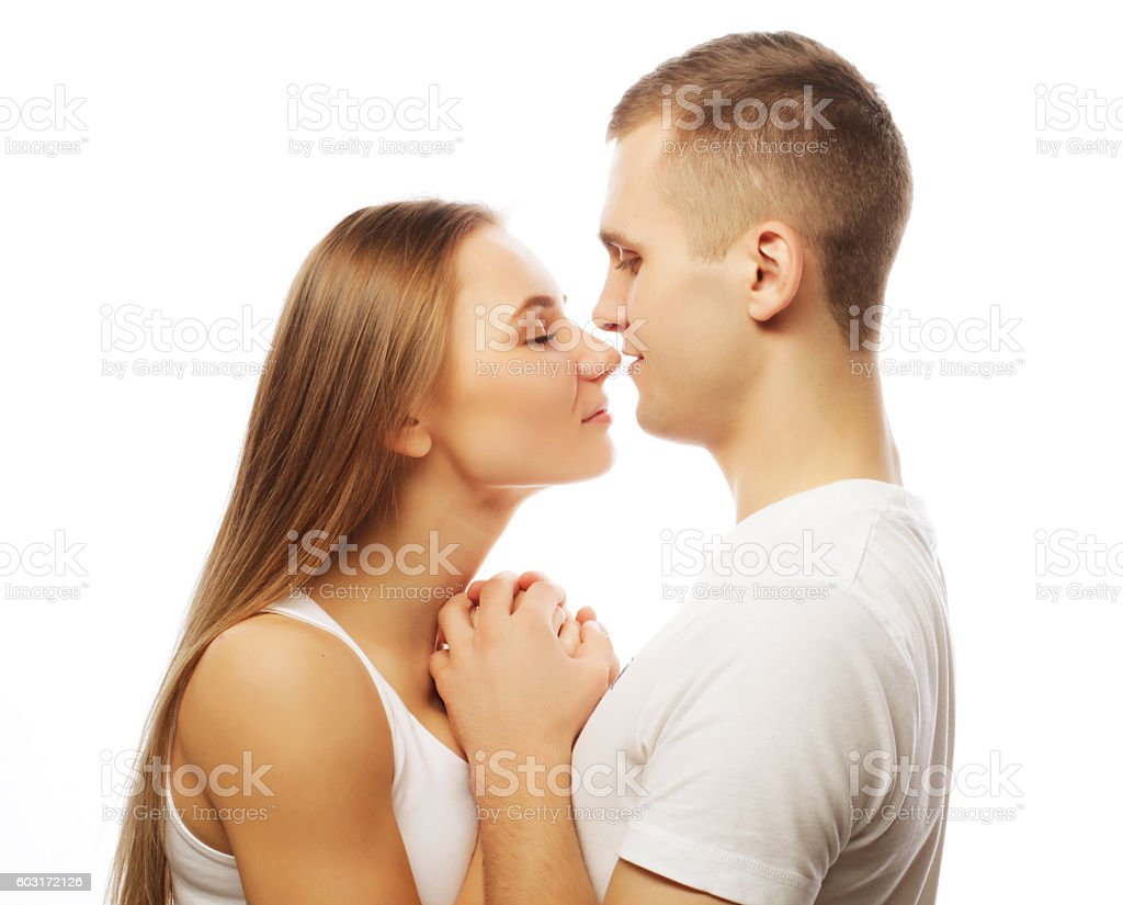 lovely happy couple hugging over white background. stock photo