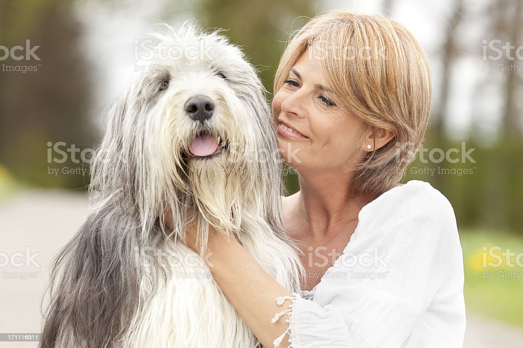 lovely hug between woman and her dog stock photo
