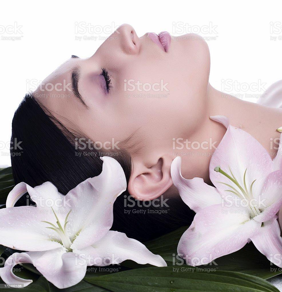 Lovely lady in massage salon stock photo