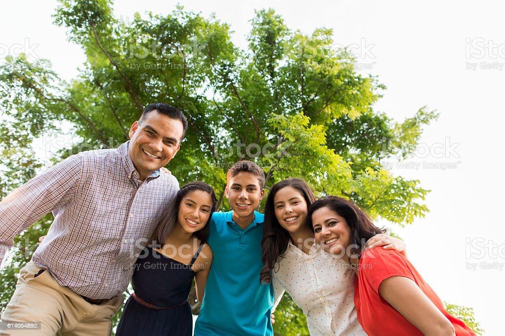 Lovely latin family smiling at camera stock photo