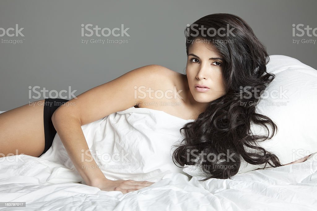 Lovely Latin Woman in Bed royalty-free stock photo
