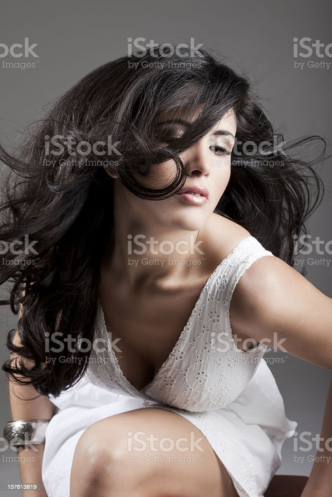 Lovely Latin Woman with Windblown Hair royalty-free stock photo
