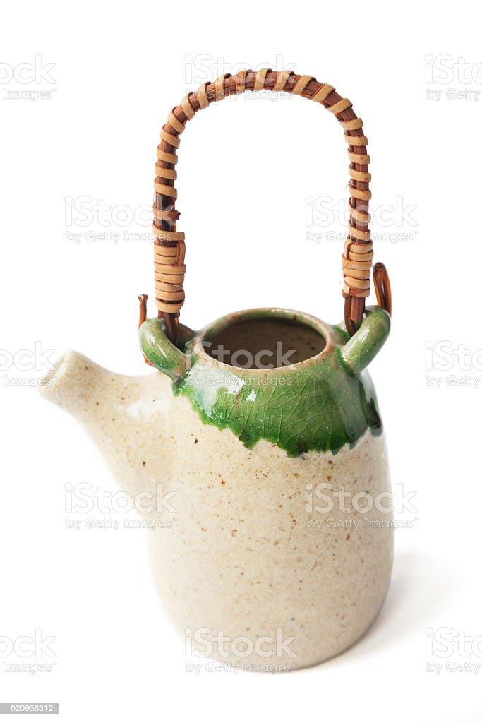 Lovely little Asian ceramic glazed teapot isolated on white stock photo
