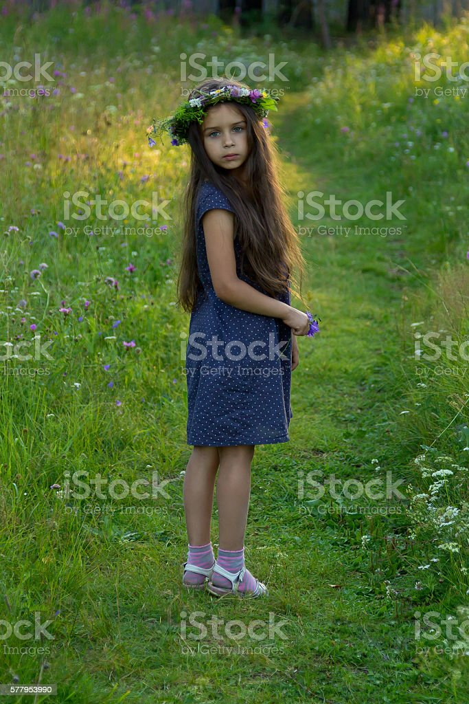 Lovely little baby girl with flower wreath on her head stock photo