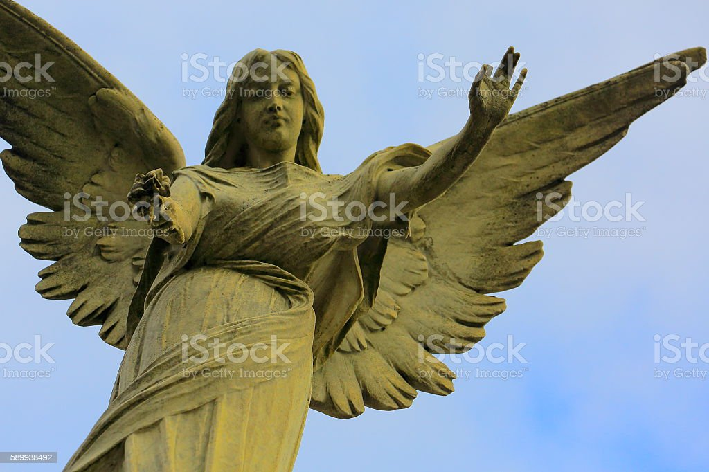 Lovely Madonna Angel offering flower, blue sky, Recoleta Cemetery stock photo