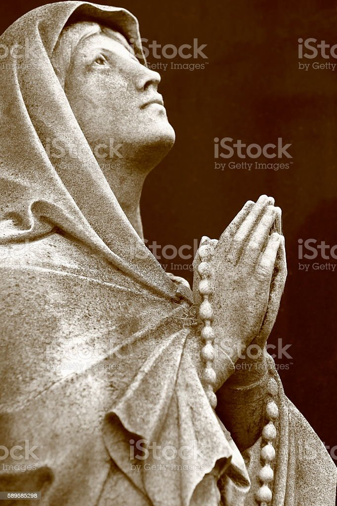 Lovely Madonna Angel praying hands clasped, Black background, Recoleta Cemetery stock photo