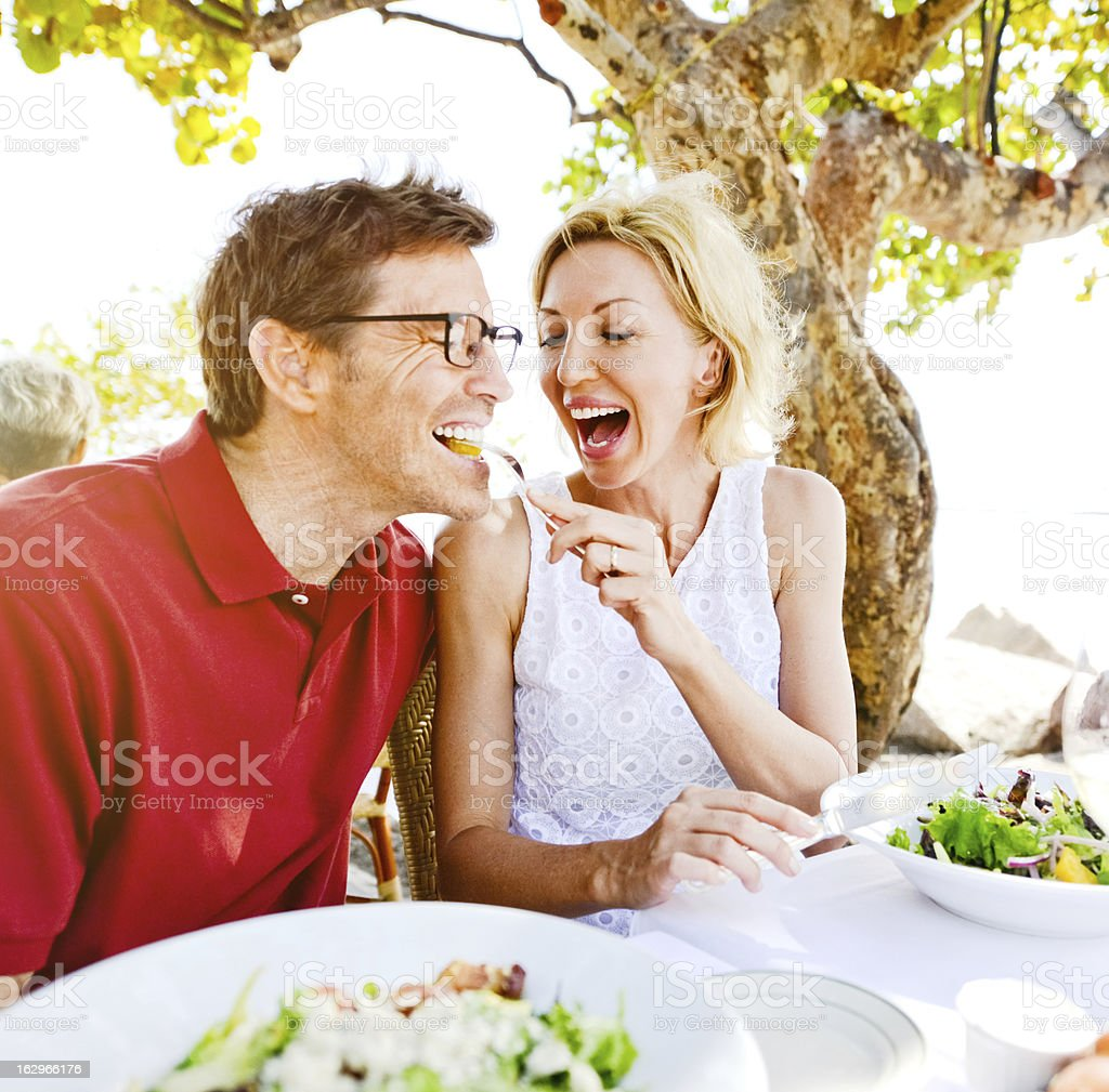 Lovely Mature Couple Enjoying Food in a Restaurant royalty-free stock photo